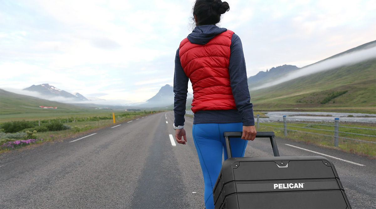 pelican waterproof luggage rolling carry-on